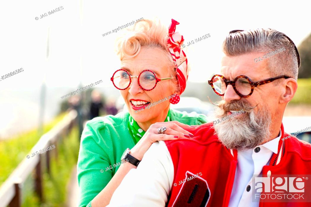 Stock Photo: Quirky couple sightseeing, Bournemouth, England.