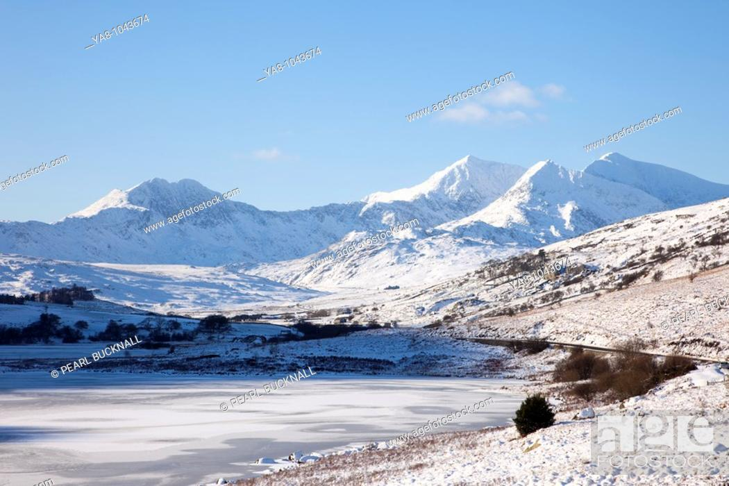 Stock Photo: Capel Curig, North Wales, UK, Europe  View across Llynnau Mymbyr frozen lakes to the Snowdon horseshoe in Snowdonia National Park with deep snow in winter.