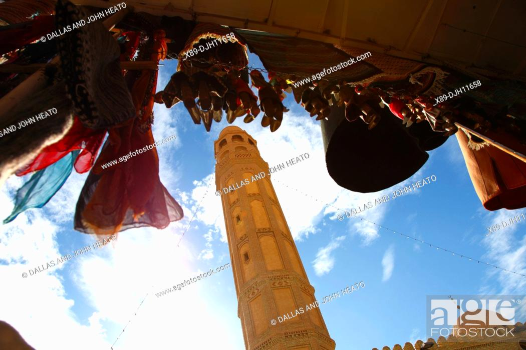 Stock Photo: Africa, North Africa, Tunisia, Tozeur, Town Mosque Minaret and Hanging Dolls in Handicraft Shop.