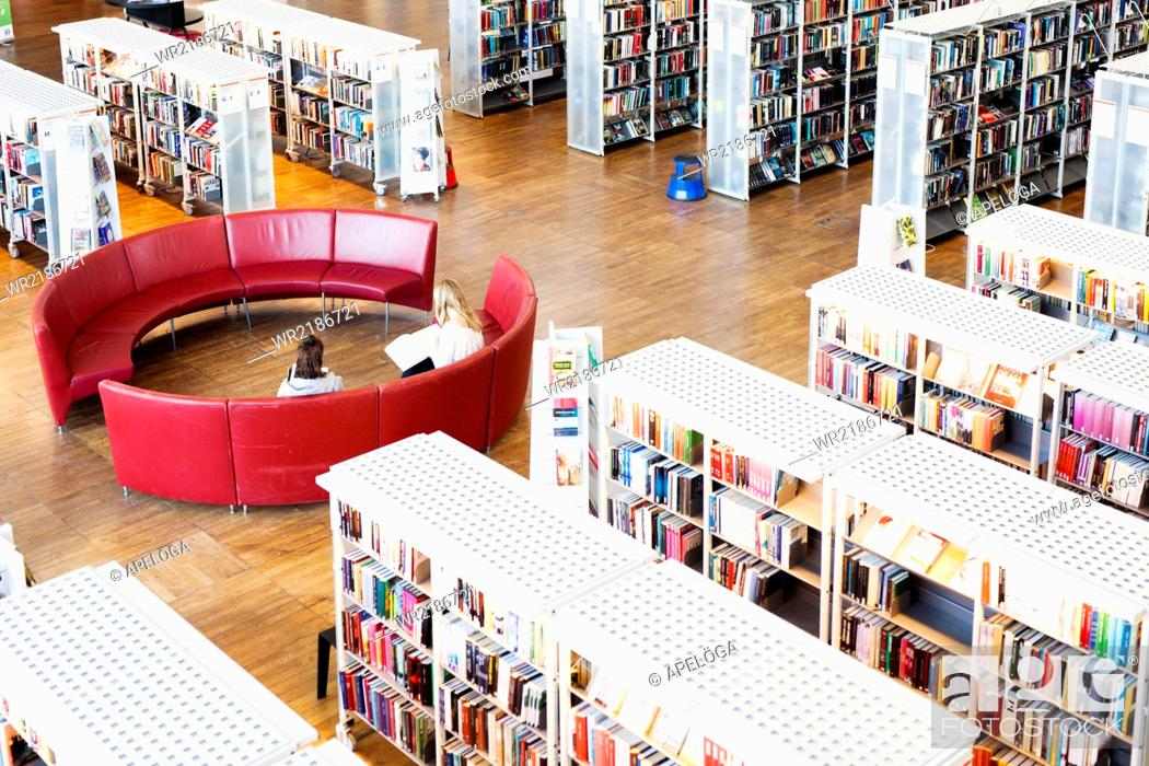 Stock Photo: High angle view of women sitting on sofa in library.