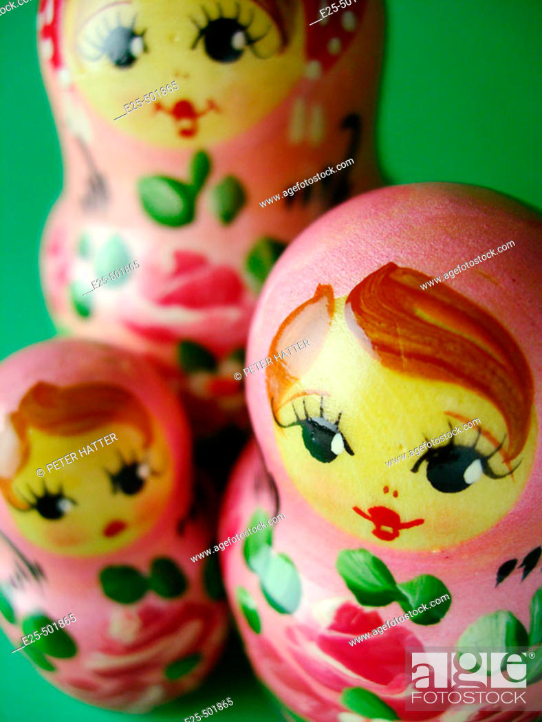 Stock Photo: Three Russian Dolls Stand Closely Together.