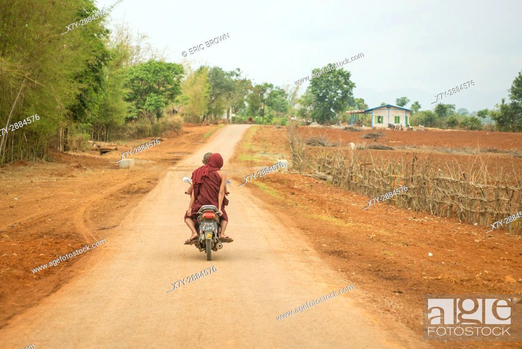 Stock Photo: A couple riding a motor scooter near Pindaya, Myanmar.