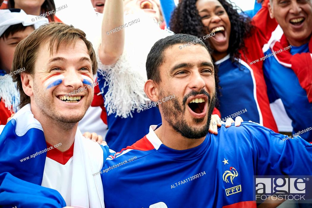 Stock Photo: French football fans watching football match.