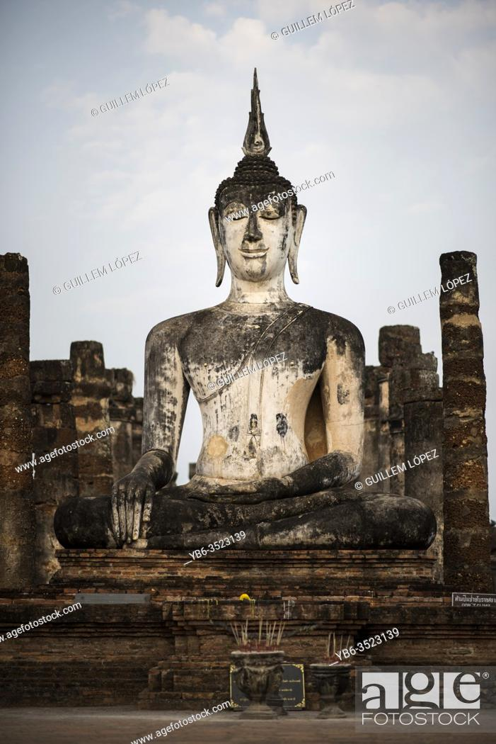 Stock Photo: Buddha statue at the Wat Mahatat temple , Sukhothai Historical Park, Sukhothai, Thailand.