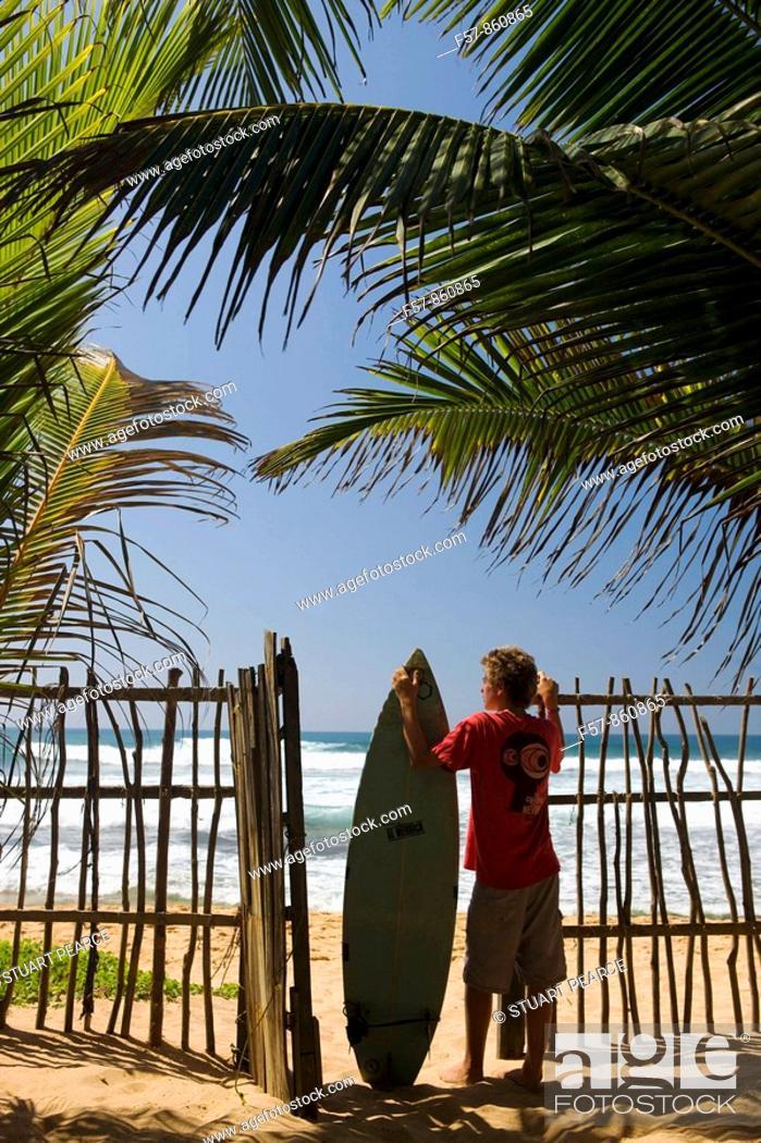 Stock Photo: Young Surfer in Hikkaduwa, Sri Lanka.