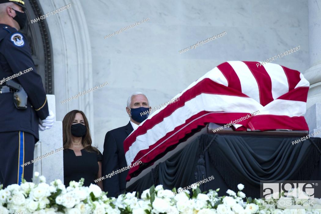 Stock Photo: Karen Pence, left, and United States Vice President Mike Pence pay their respects as Representative John Lewis (Democrat of Georgia) lies in state on the steps.