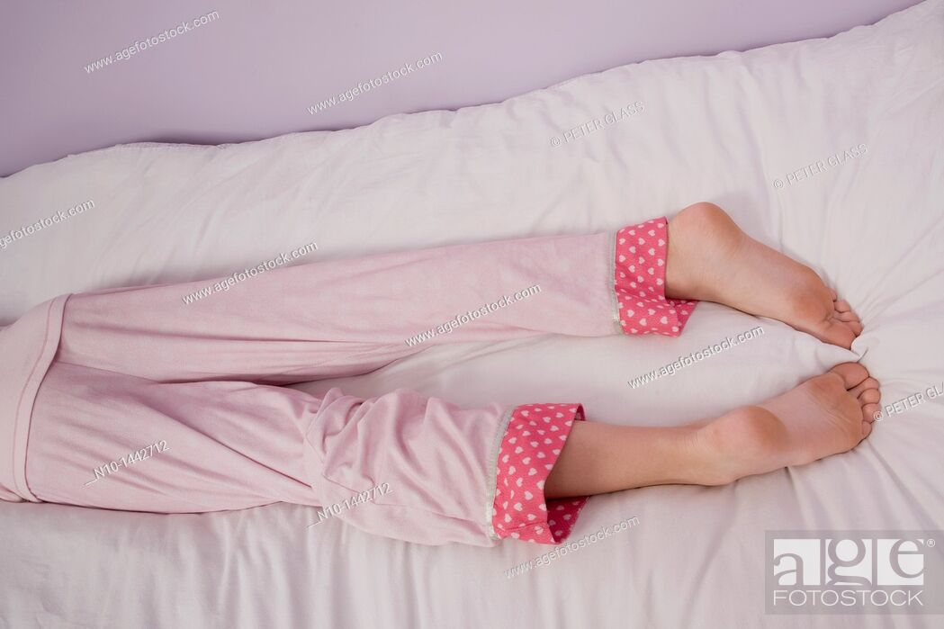 Stock Photo: Preteen girl's legs and feet.