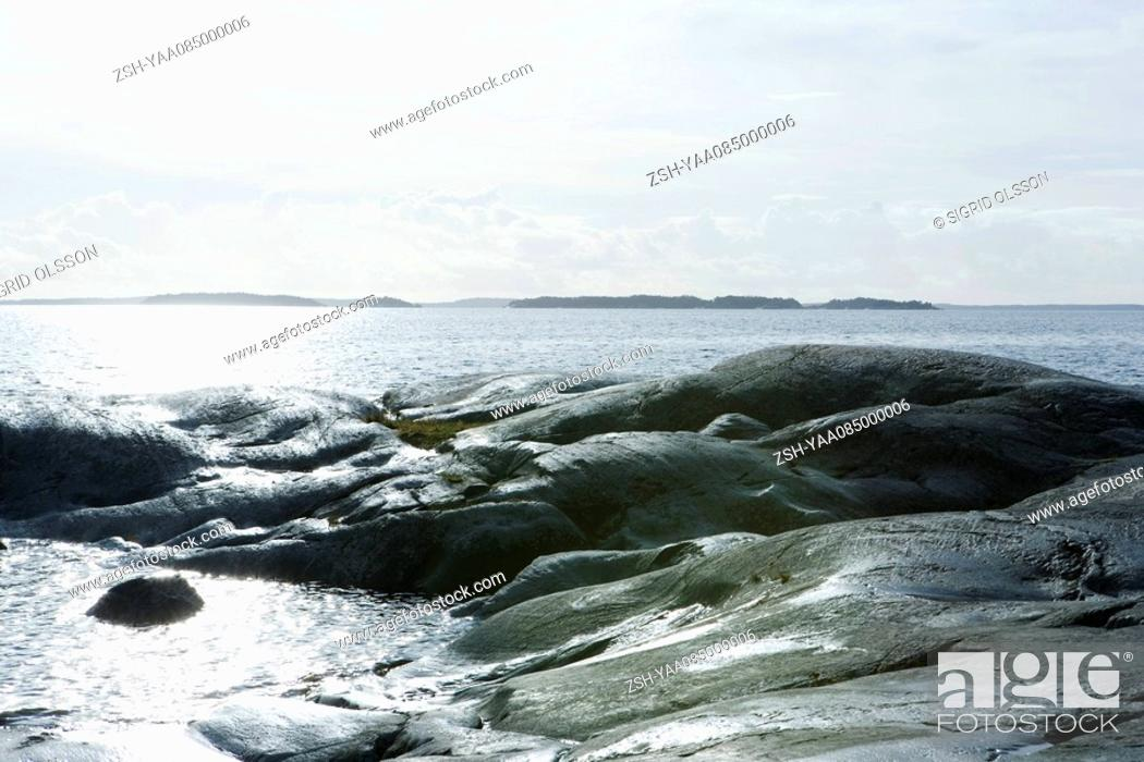 Stock Photo: Seascape with rocky outcropping.