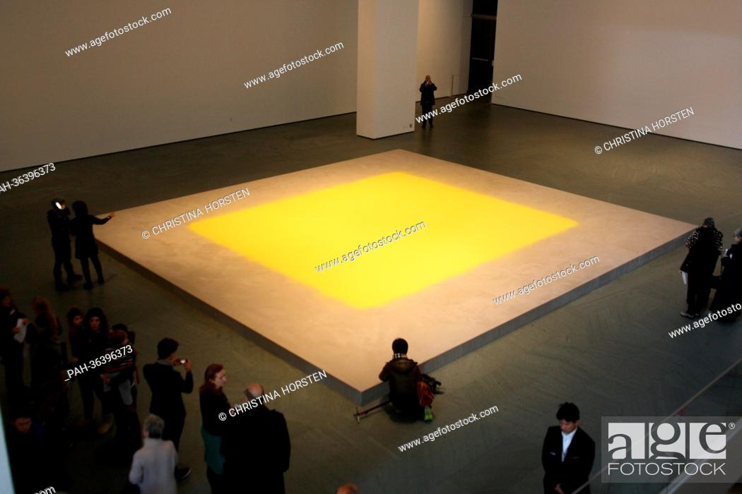 Stock Photo: A field of yellow hazelnut pollen titled 'Pollen from Hazelnut' by Swabian artist Wolfgang Laib is on display at the Museum of Modern Art (MoMA) in New York.