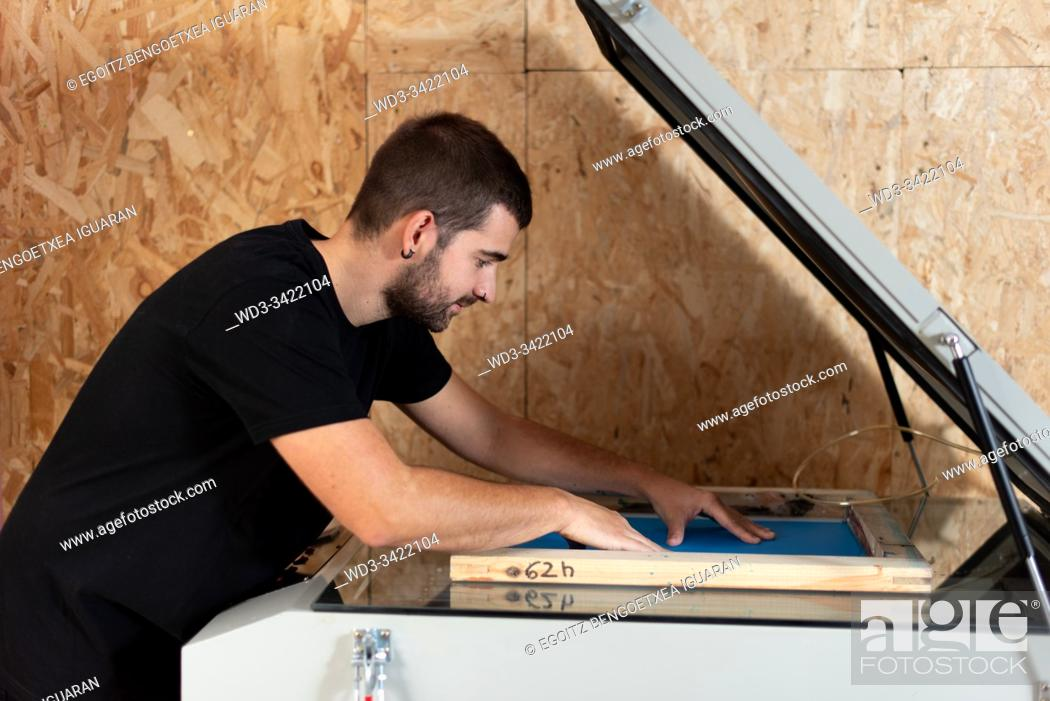 Stock Photo: Print on fabric process. Vacuum and exposure machine to make silkscreen patterns.