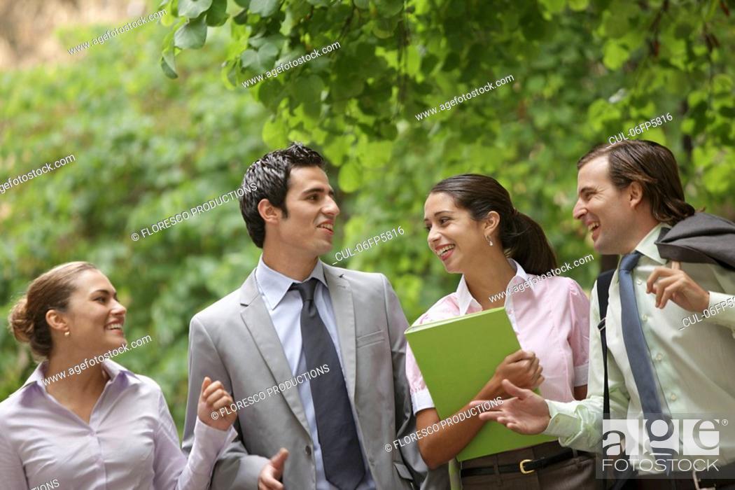 Stock Photo: Business team talking on street.