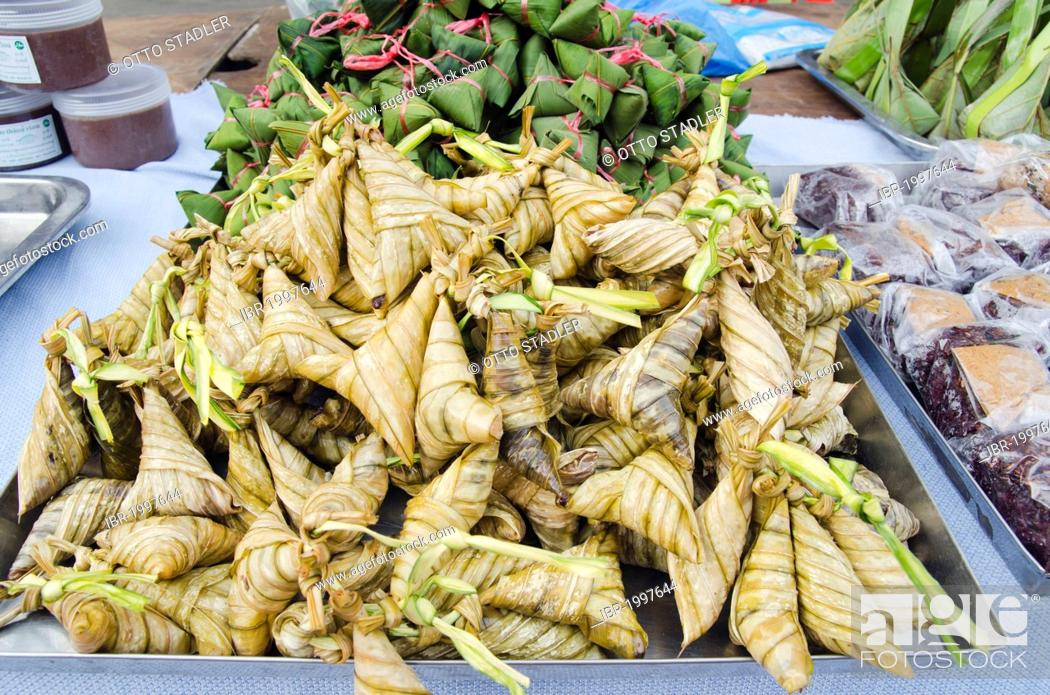 Thai Food Wrapped In Banana Leaves On The Night Market In