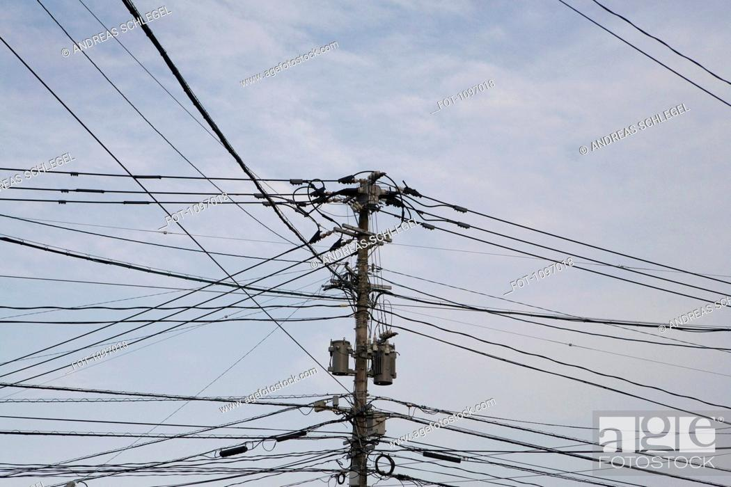 Stock Photo: Detail of a utility pole and connecting cables.