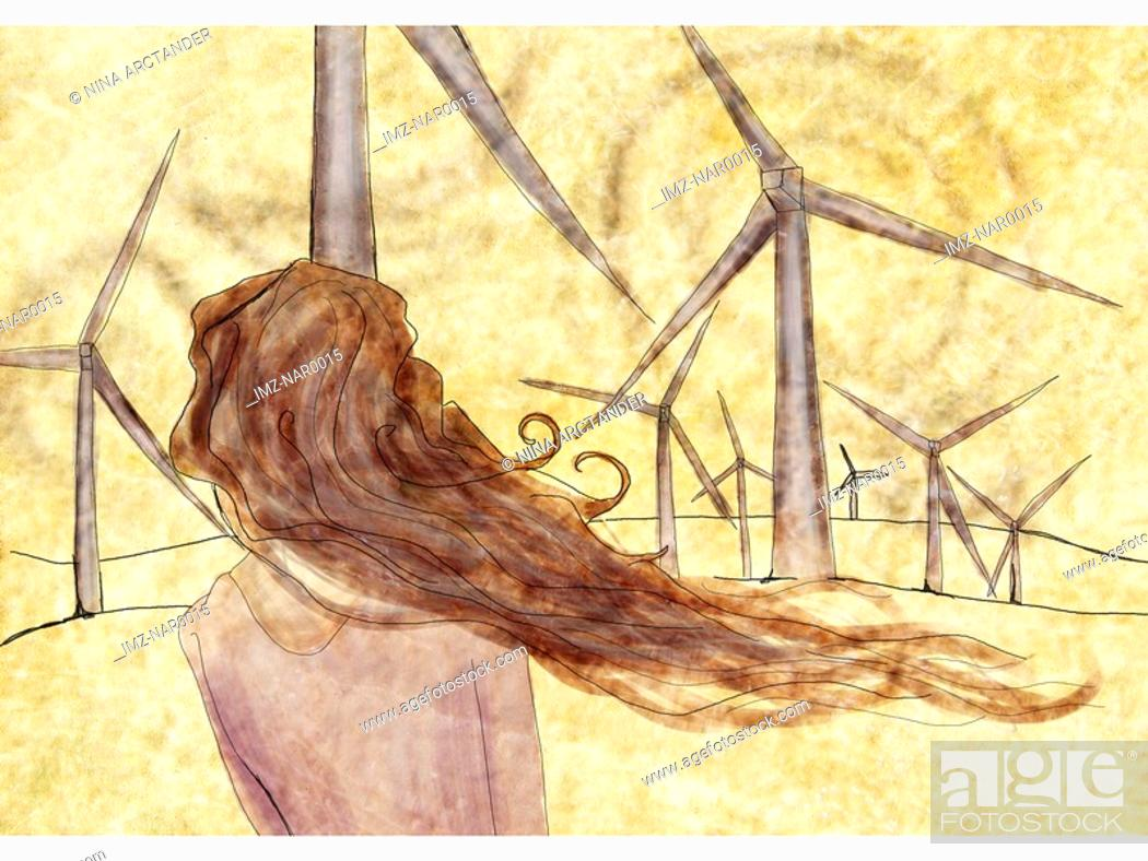 Stock Photo: A woman standing in front of wind mills.