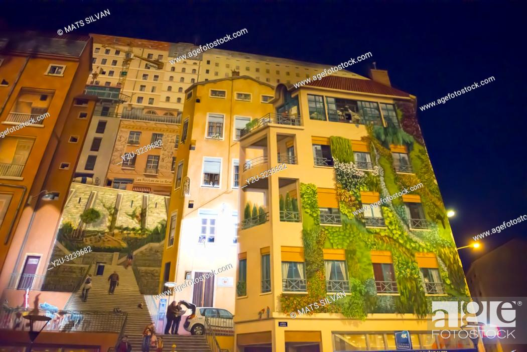 Stock Photo: Painted Facade Wall on a Building in Lyon at Night in Auvergne-Rhone-Alpes, France.