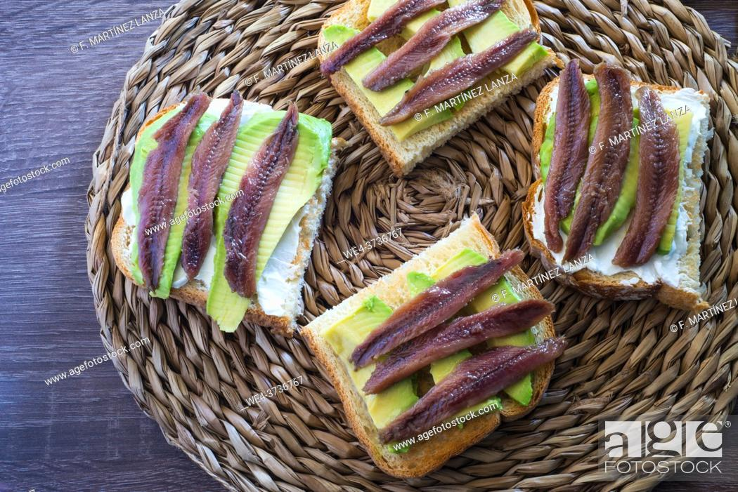 Stock Photo: Toast with avocado and anchovy spread.