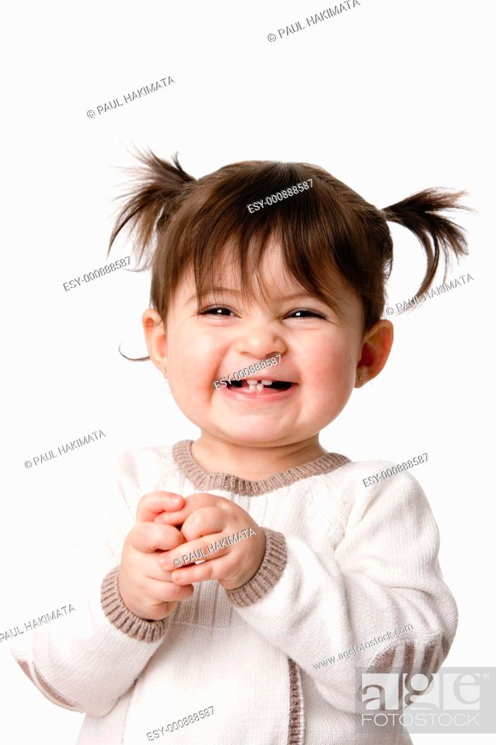 Stock Photo: Beautiful expressive adorable happy cute laughing smiling baby infant toddler girl with ponytails showing teeth, isolated.