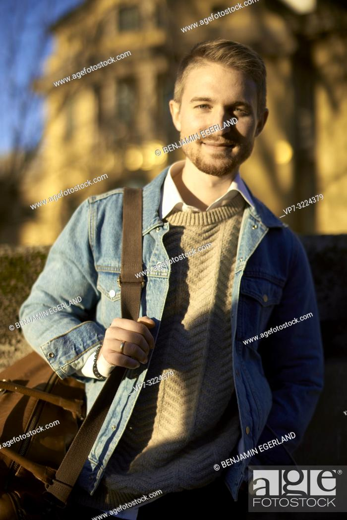 Stock Photo: young man, portrait, in Munich, Germany.