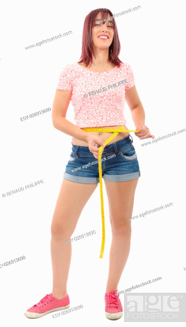 Stock Photo: young woman measuring her waist on white background.
