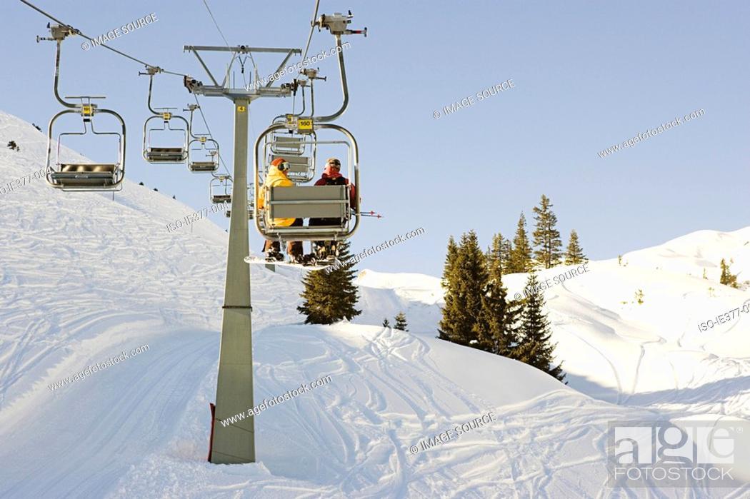 Stock Photo: Two men on a ski lift.
