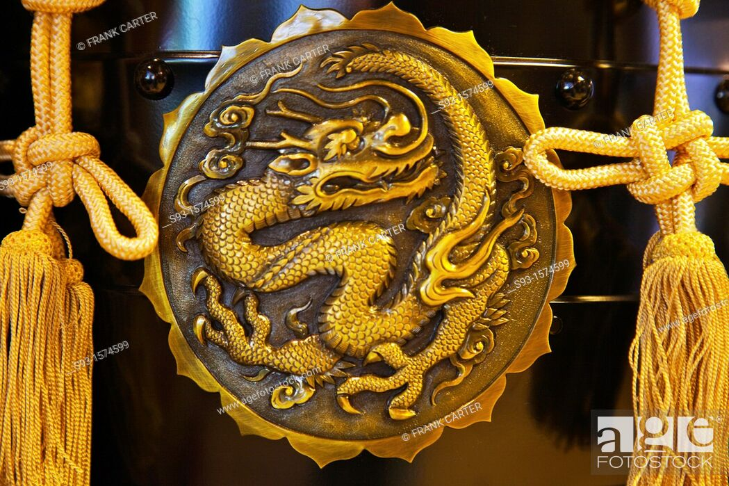 Stock Photo: A close-up of a dragon design on a metal disk.