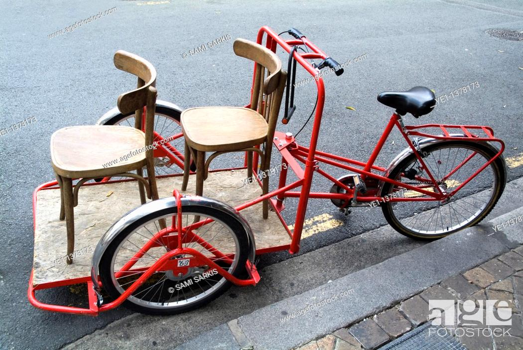 Stock Photo: Two chairs on a red rickshaw, Old Bordeaux City, France.