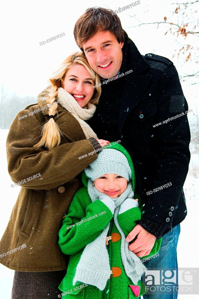 Stock Photo: Portrait of family in snow.