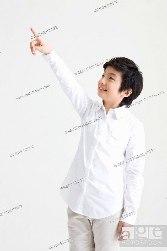 Stock Photo: boy pointing something.