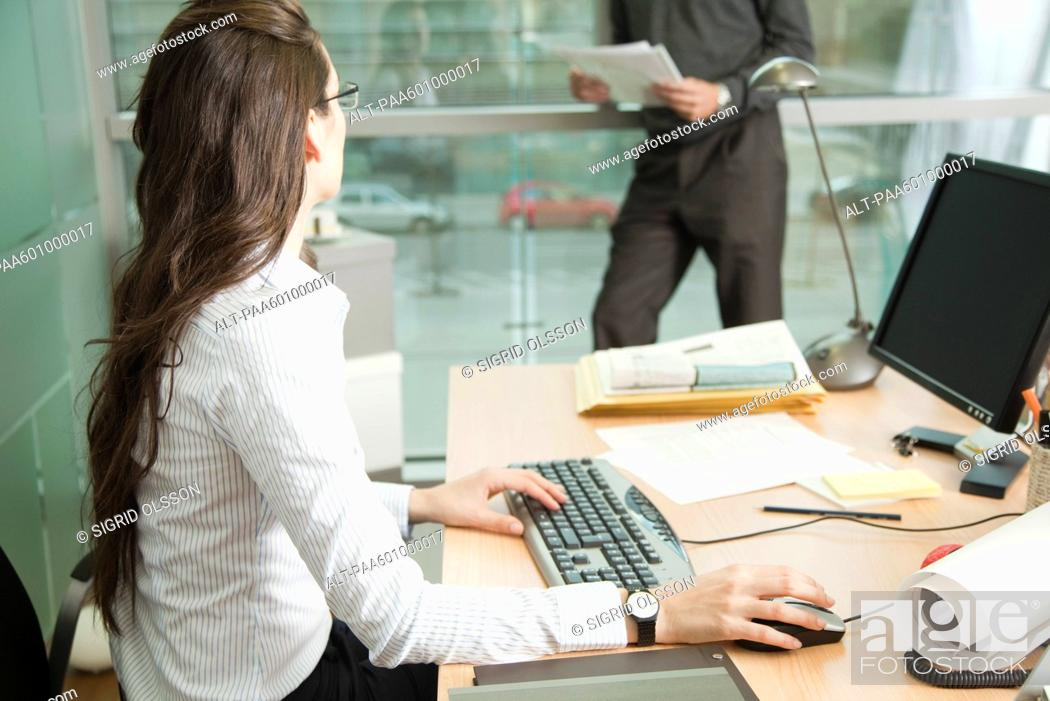 Stock Photo: Businesswoman working with colleague.