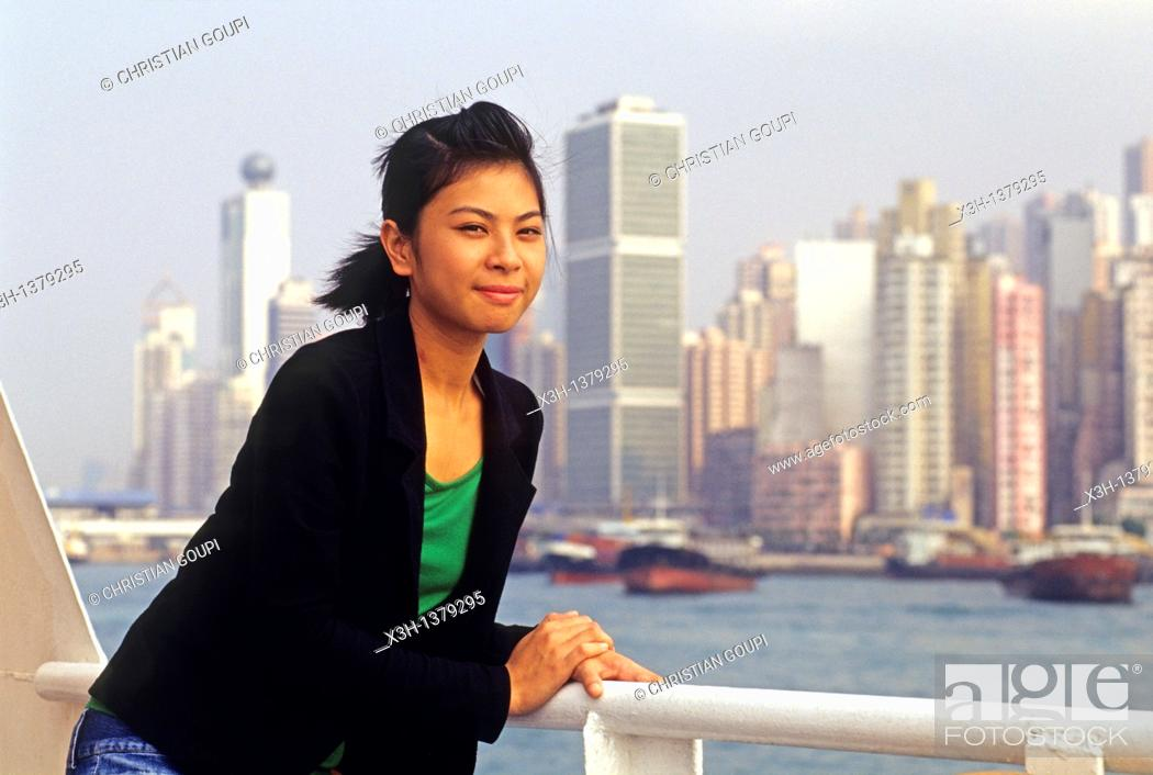 Stock Photo: young Chinese girl aboard the ferry, Victoria Harbour between Hong-Kong Island and Kowloon peninsula, People's Republic of China, Asia.