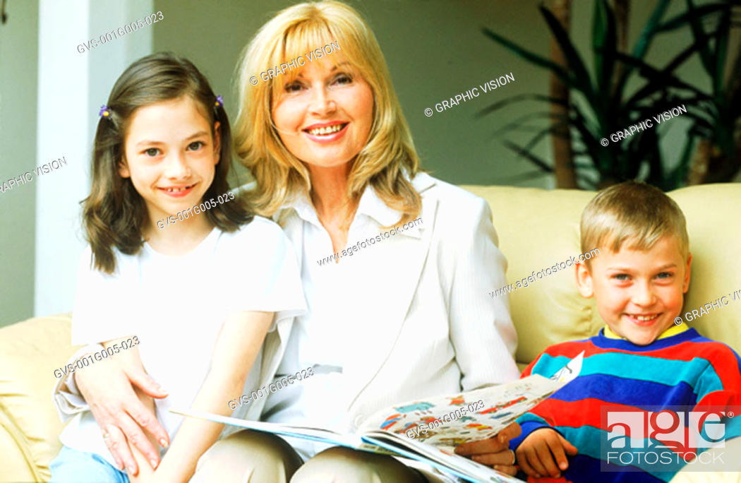 Stock Photo: Portrait of a mature woman with two children.
