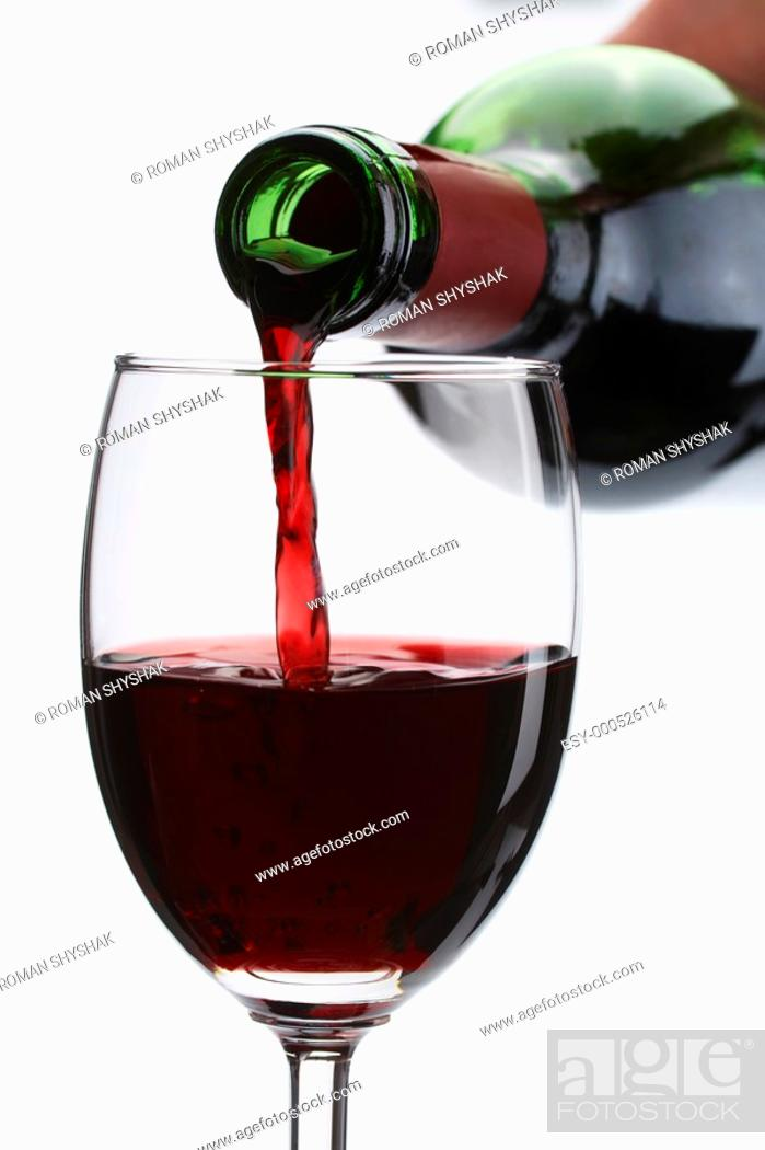 Stock Photo: Red wine pour in a glass on white background.