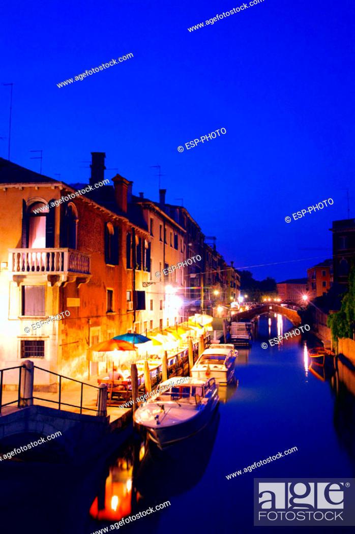 Stock Photo: Restaurant on canal at dusk. Venice. Italy.