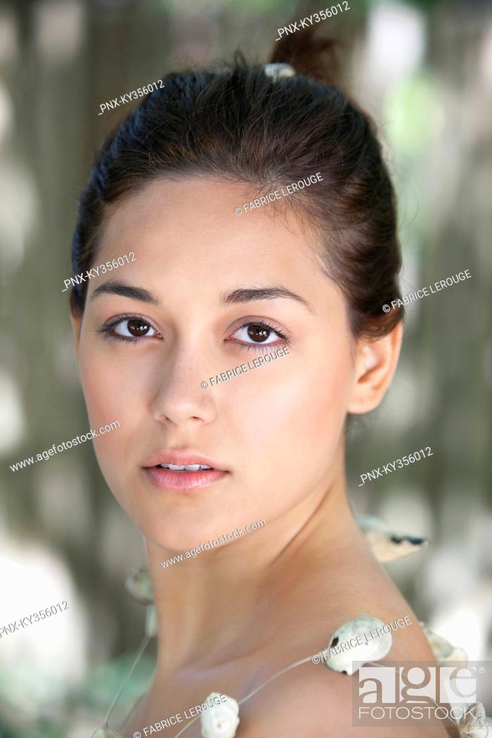 Stock Photo: Portrait of a beautiful young woman wearing shell's necklace.