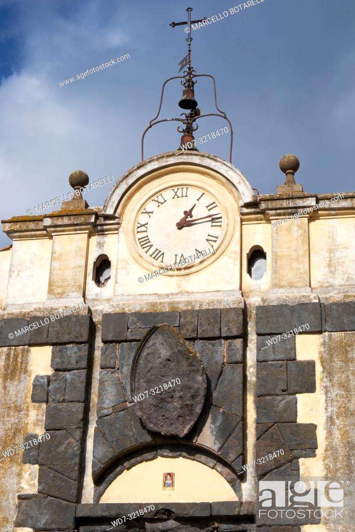 Stock Photo: antique clock with bells above the entrance door of the city, anguillara sabazia, lazio, italy.