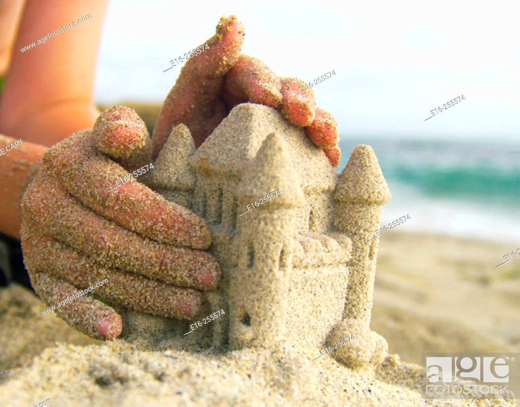 Stock Photo: making a sand castle.