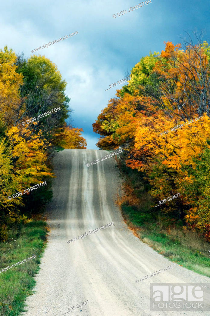 Stock Photo: Country road and fall colour. Manitoulin Is., Ontario, Canada.
