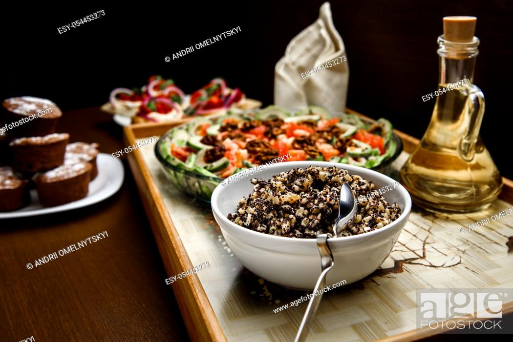 Stock Photo: boiled rice with raisins and honey with oil and salad.