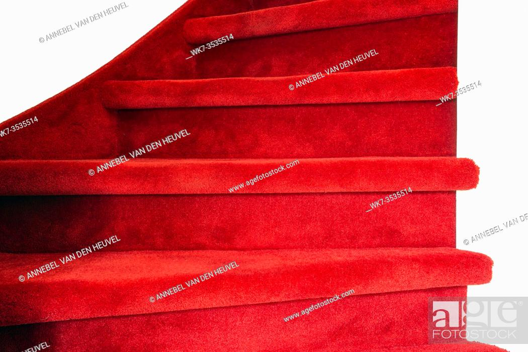 Photo de stock: Red carpet on white wooden stairs in a home, close-up luxury modern interior colorful.