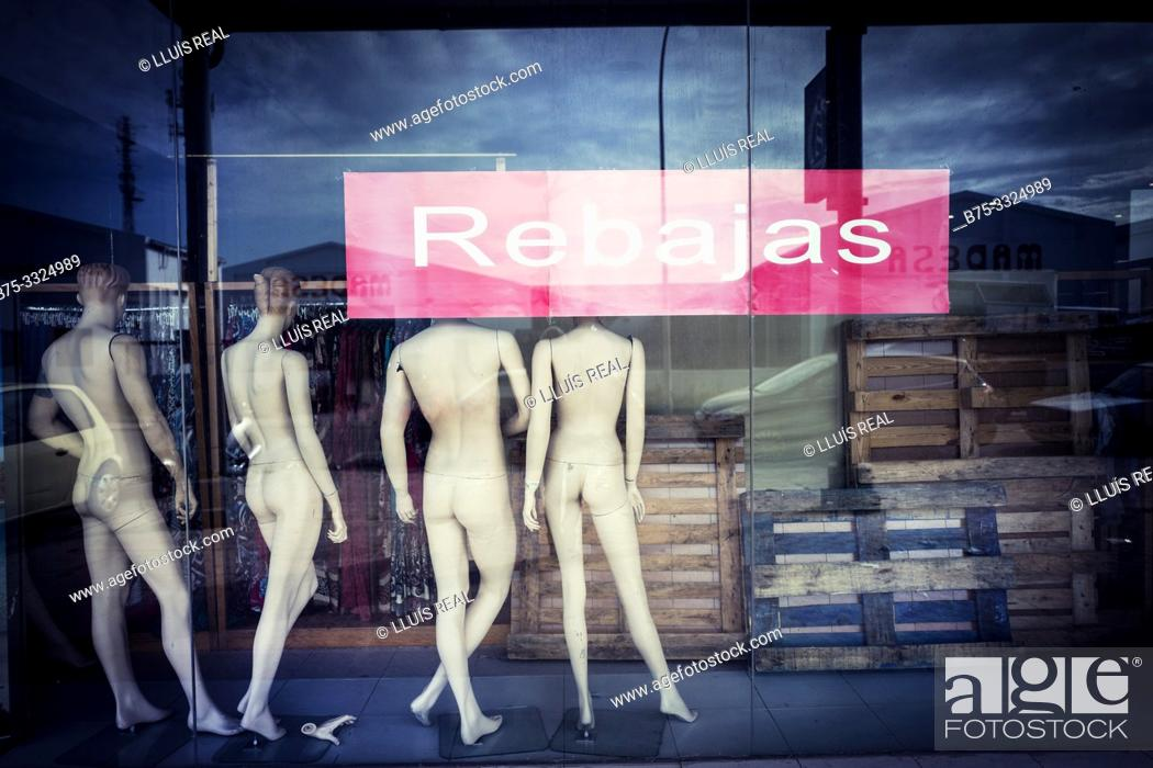 Stock Photo: Back View of naked mannequins in the shop window with the sign Retail. Mahon, Balearic Islands, Spain, Europe.