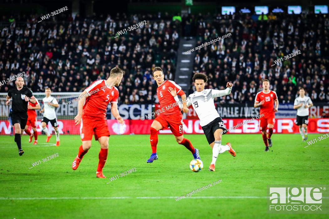 Stock Photo: Wolfsburg, Germany, March 20, 2019: Leroy Sané (GER) in action against Serbian opponents during the international game Germany vs Serbia.