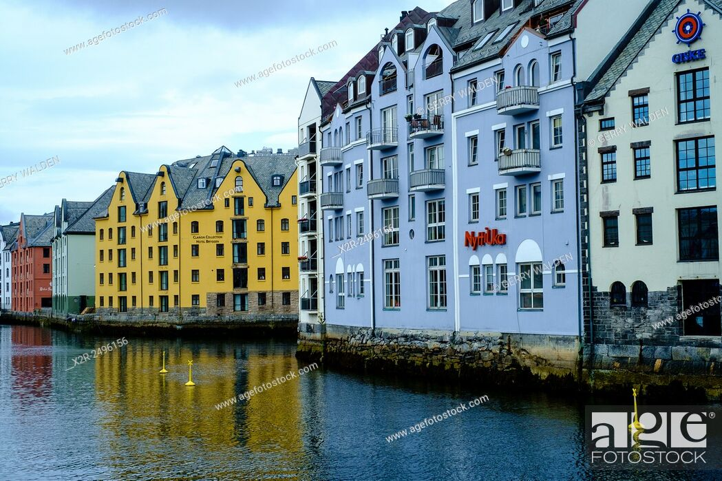 Stock Photo: The inner harbour at Alesund (Norway) showing the frontages of old warehouse buildings.