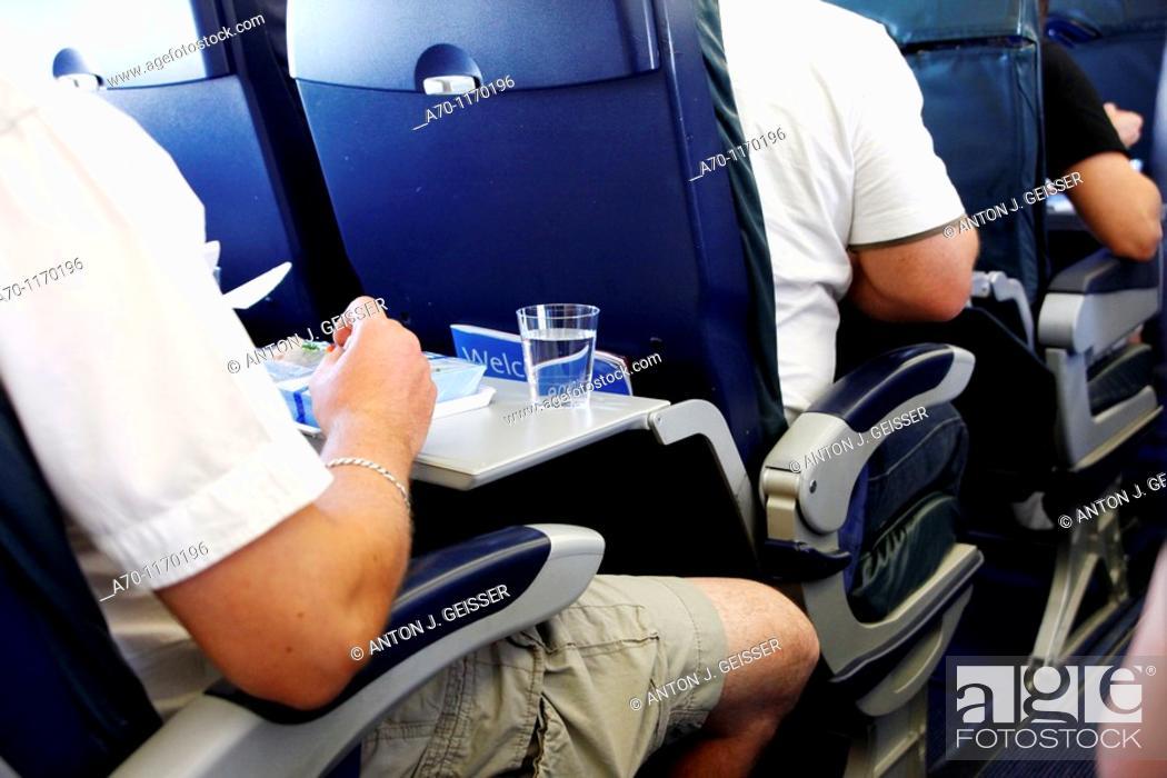 Stock Photo: Passenger during a flight.