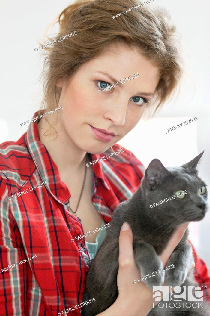 Stock Photo: Woman holding a black cat.