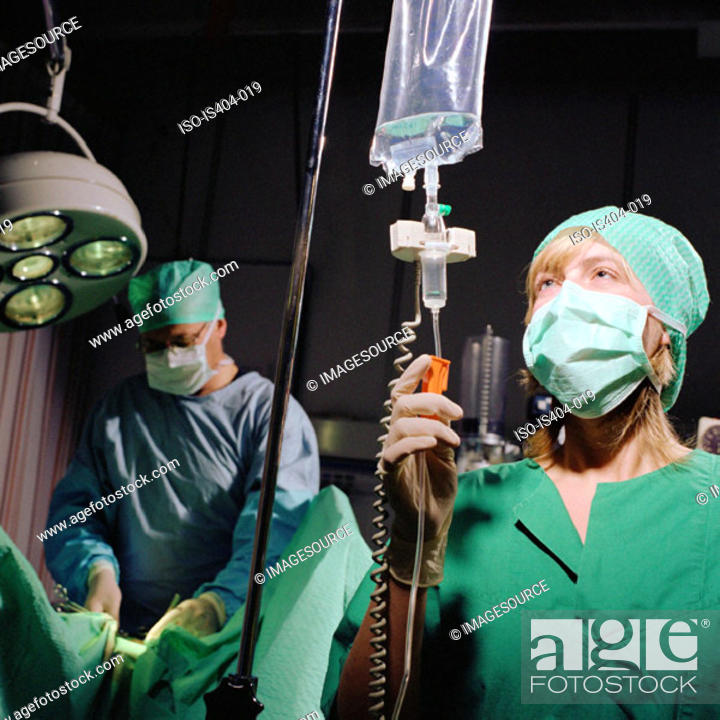 Stock Photo: Nurse monitoring fluids.