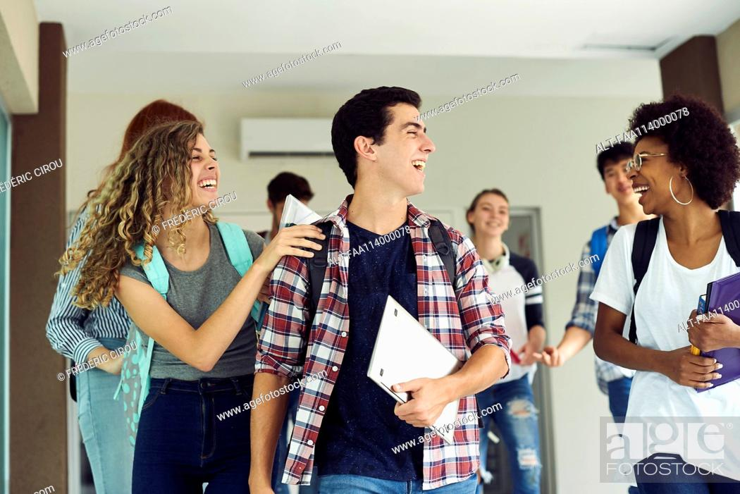 Stock Photo: Students laughing as they walk together on campus.