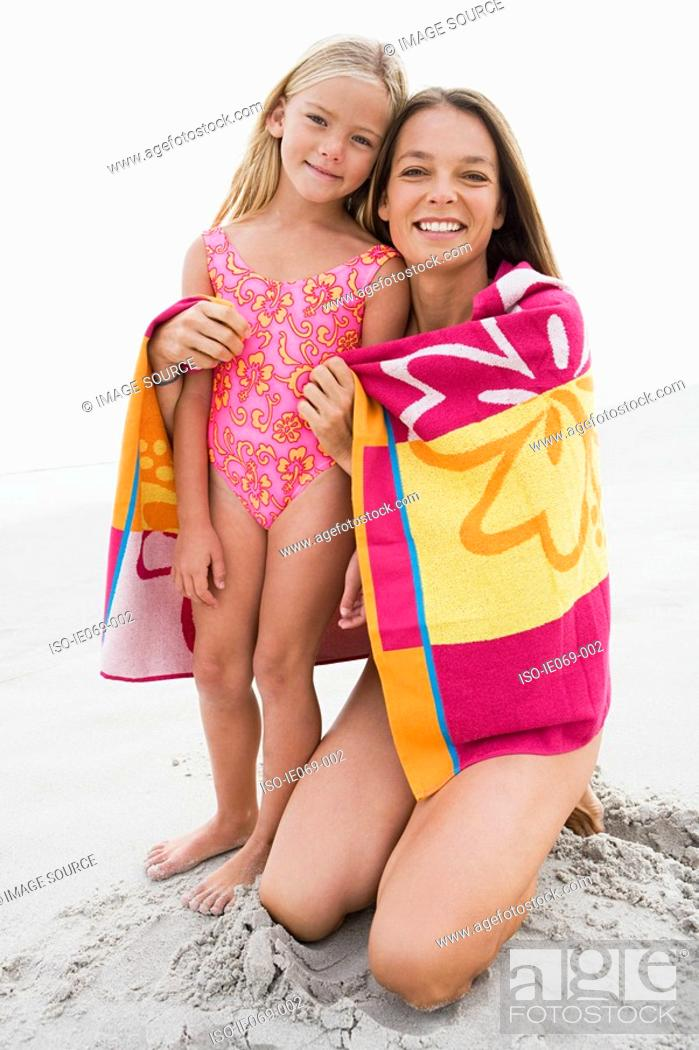 Stock Photo: Mother and daughter at beach.