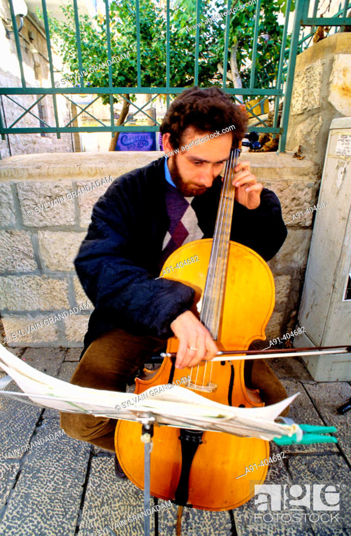 Russian jewish cellist playing classical music in the street