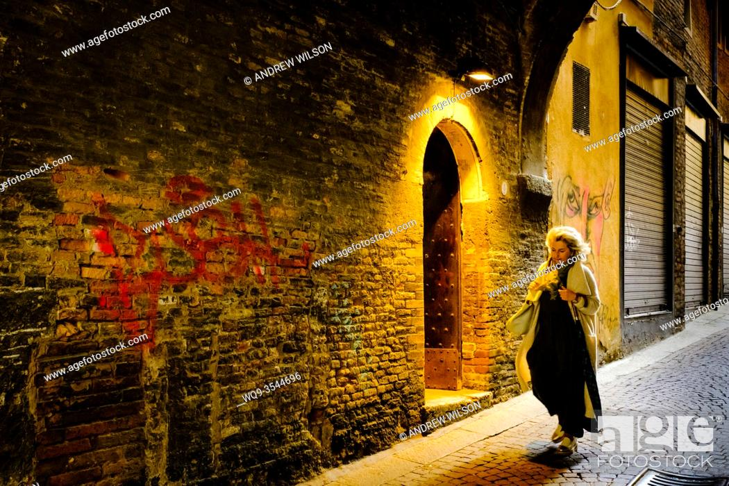 Stock Photo: An interesting doorway in the Via de' Foscherari - a cobbled street in old Bologna, Italy.