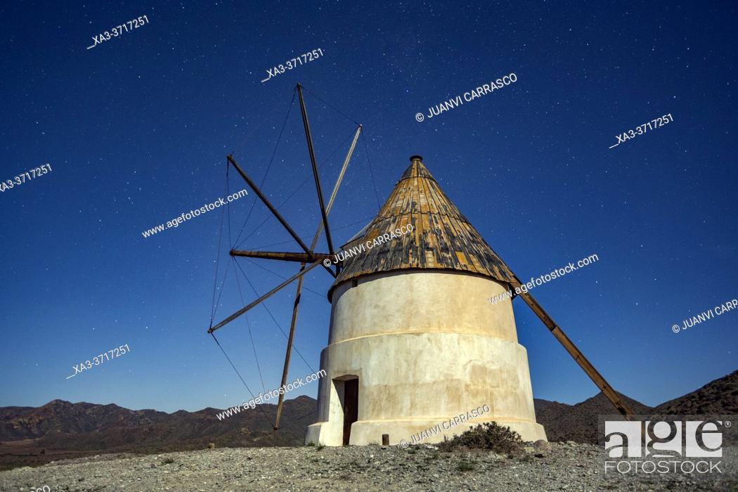 Stock Photo: Windmill at night in San Jose, Cabo de Gata natural park, Almeria, Spain.